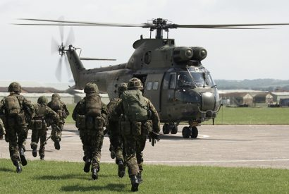 UK soldiers board puma helicopter