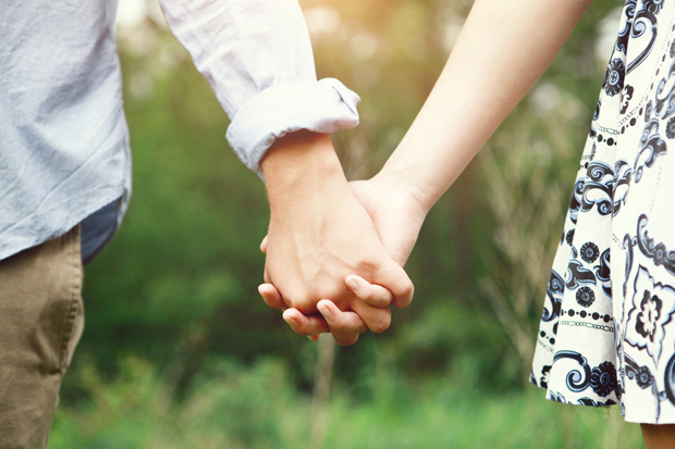 Young Couple Holding Hands Outside
