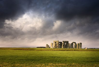 Distant overview of Stonehenge against stormy skies