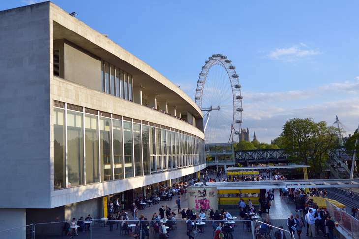 Visitors outside the Royal Festival Hall in with London Eye